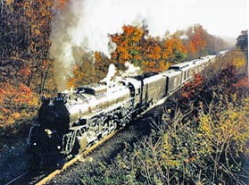 Family vacation train travel on private railcars can include steam locomotives